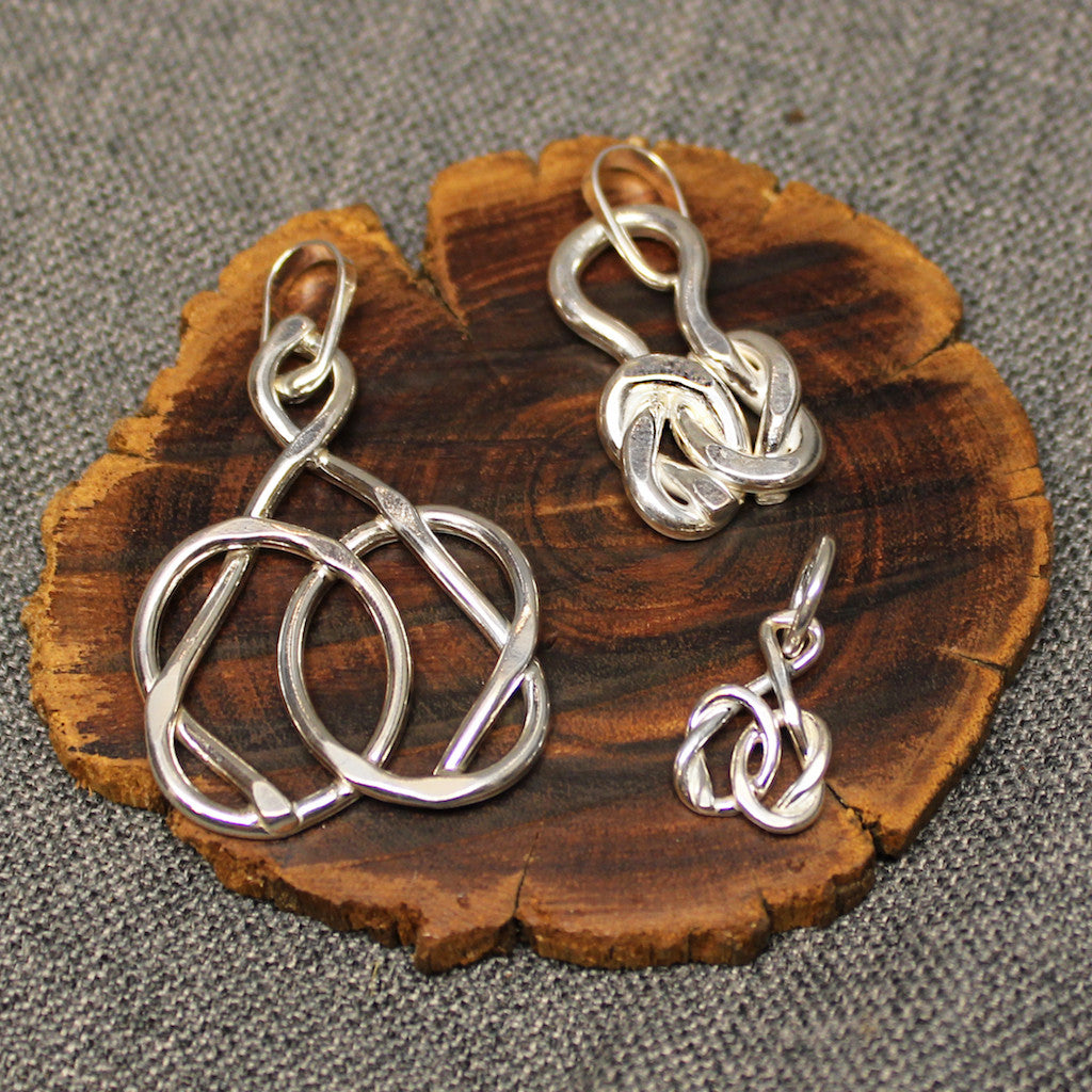 Small, medium and large sterling silver pendants with friendship knot design.