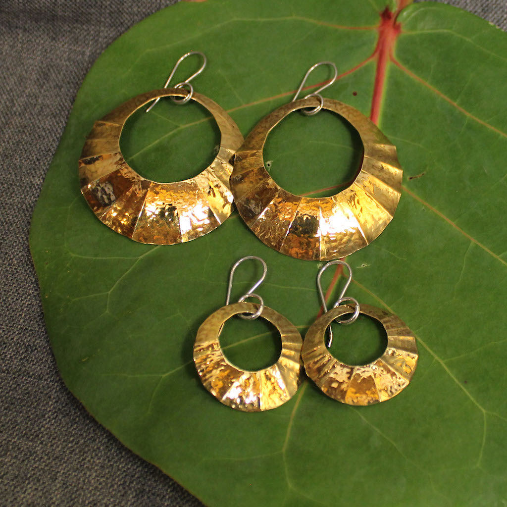 Small and large hammered circular brass earrings.