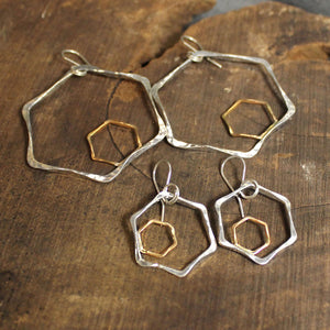 Sterling silver and 14k gold hexagonal 2-tone earrings.