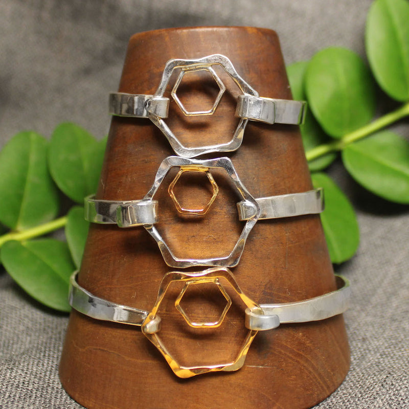Sterling silver, 14k gold and 2 tone 5mm latching bracelet with small and large hexagonal design in center.