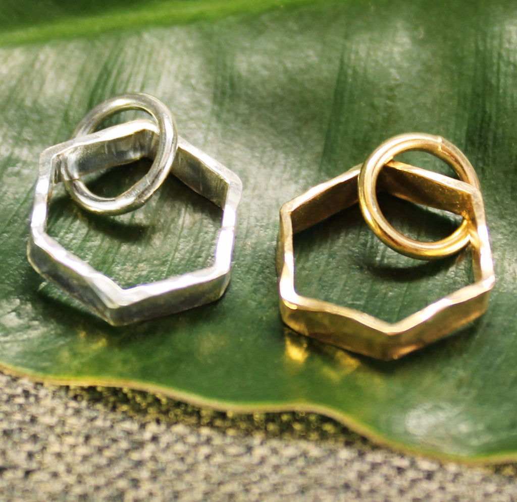 Sterling silver and 14k gold hexagonal charm.