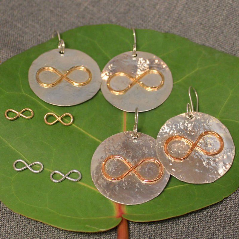 Hammered sterling silver disc earrings with copper or 14k gold infinity symbol in center. Small sterling silver and 14k gold infinity symbol post earrings also pictured.