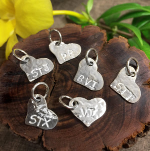 Hammered sterling silver flat heart shaped charms with STX, VI, STT, STJ, PR and BVI engraving.