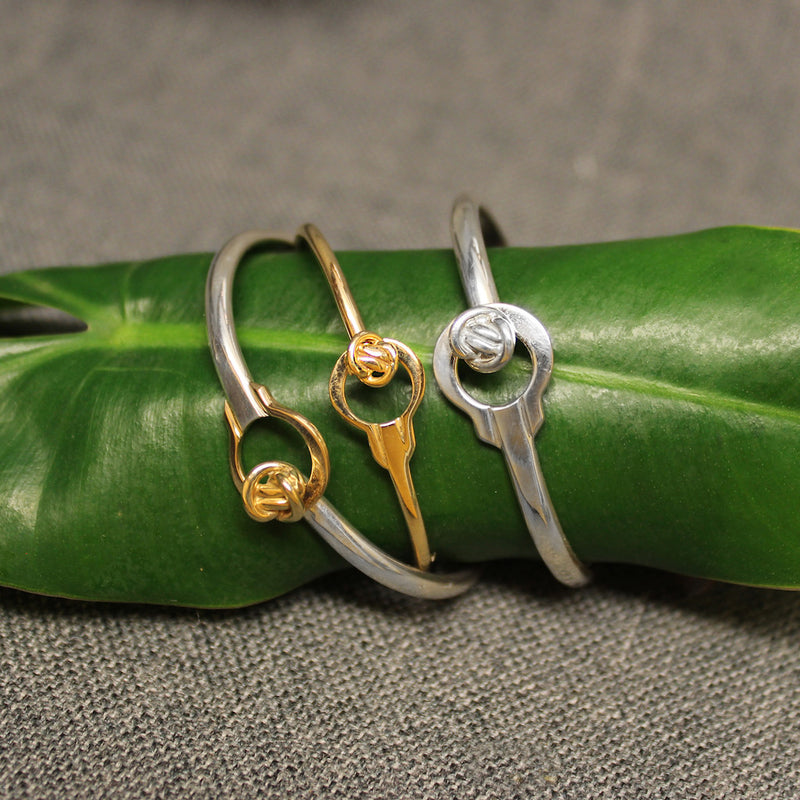 3mm Sterling silver, 14k gold and 2-tone latching bracelet for child with circular Crucian knot design.