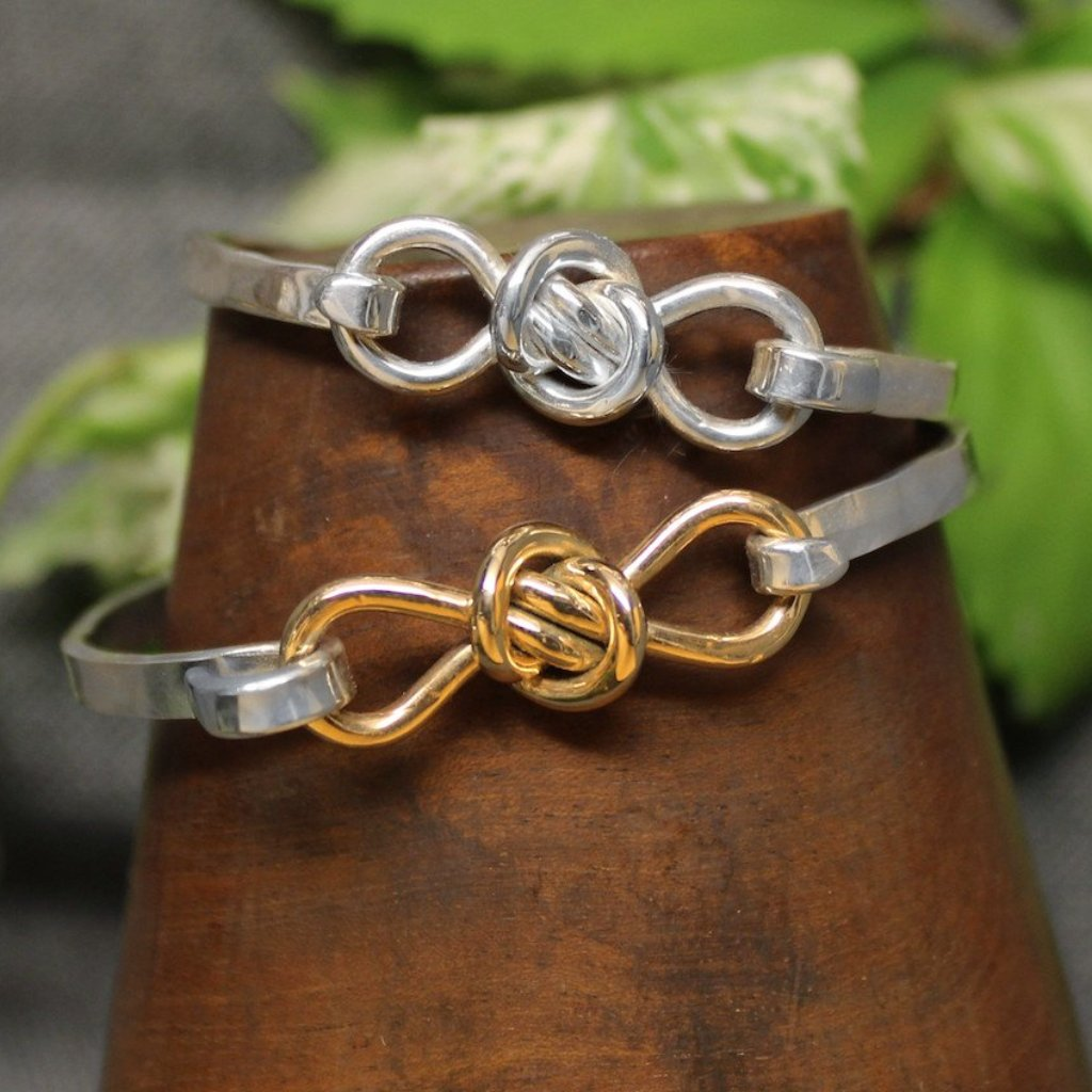 Sterling silver and 2- tone Sterling silver and 14k gold bracelets with infinity symbol shaped Crucian knot design.