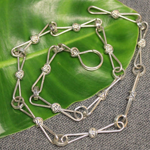 Sterling silver chain with love knot links.