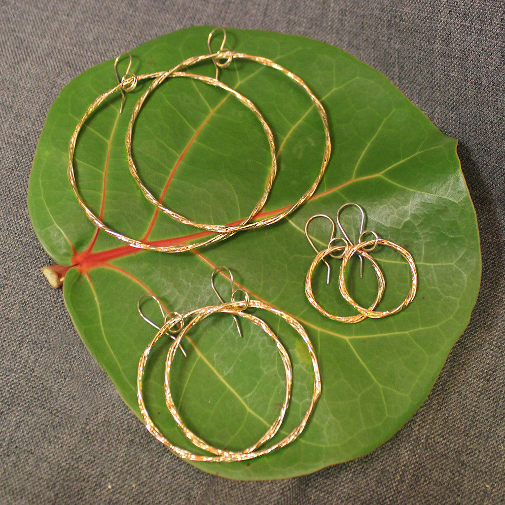Handcrafted artisanal 14k gold hoop earrings.