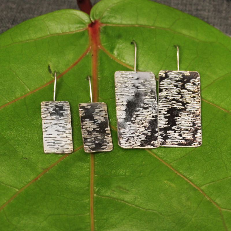 Small and medium sterling silver earrings with hammered rectangular plate.