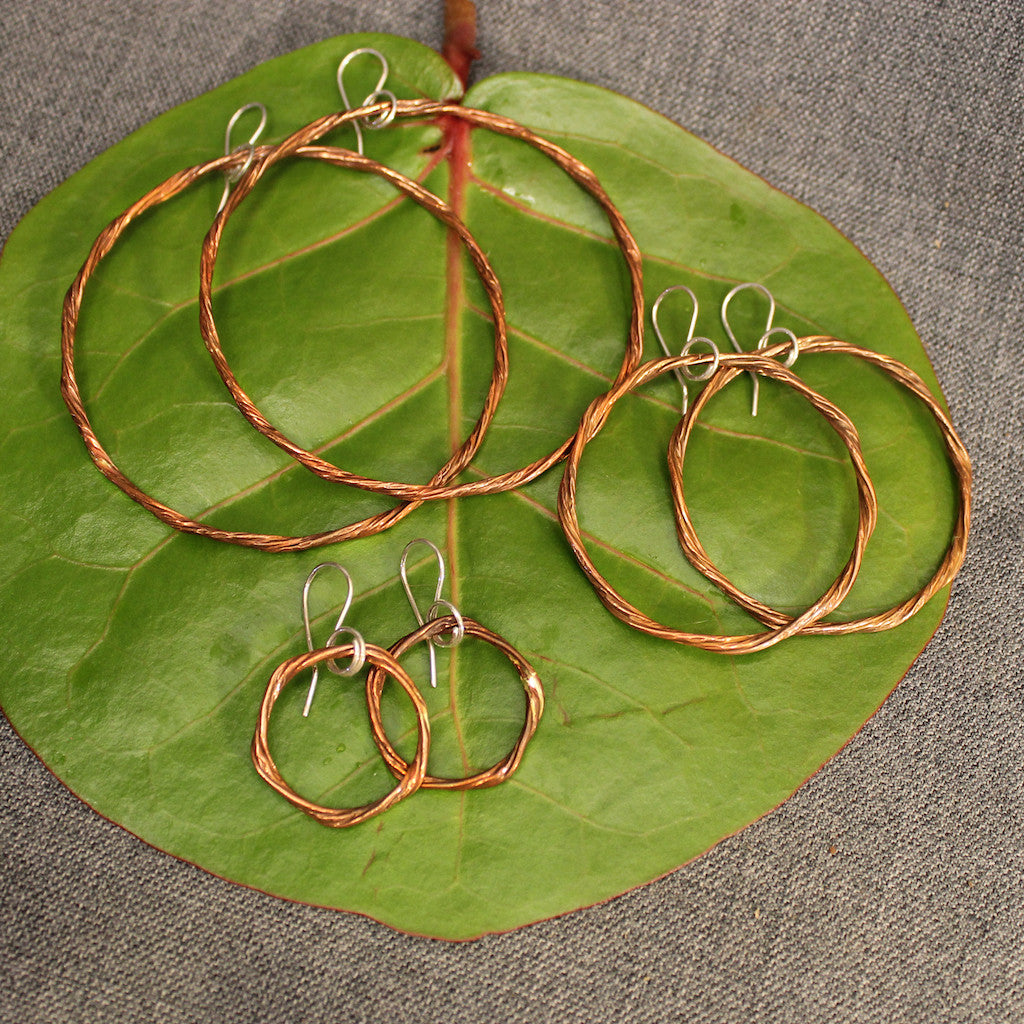 Handcrafted small, medium and large copper hoop earrings.
