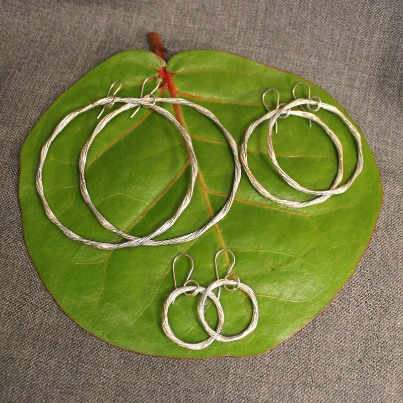 Handcrafted small, medium and large sterling silver hoop earrings.