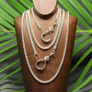 Sterling silver heavy wheat chain with love knot clasp.