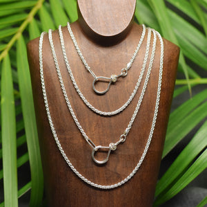 Sterling silver medium wheat chain with love knot clasp.