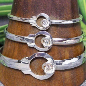 Sterling silver bracelets in 3 different sizes with circular Crucian knot design.