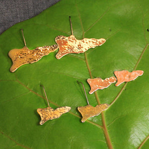 Hammered 14k gold earrings shaped like the map of St. Croix.