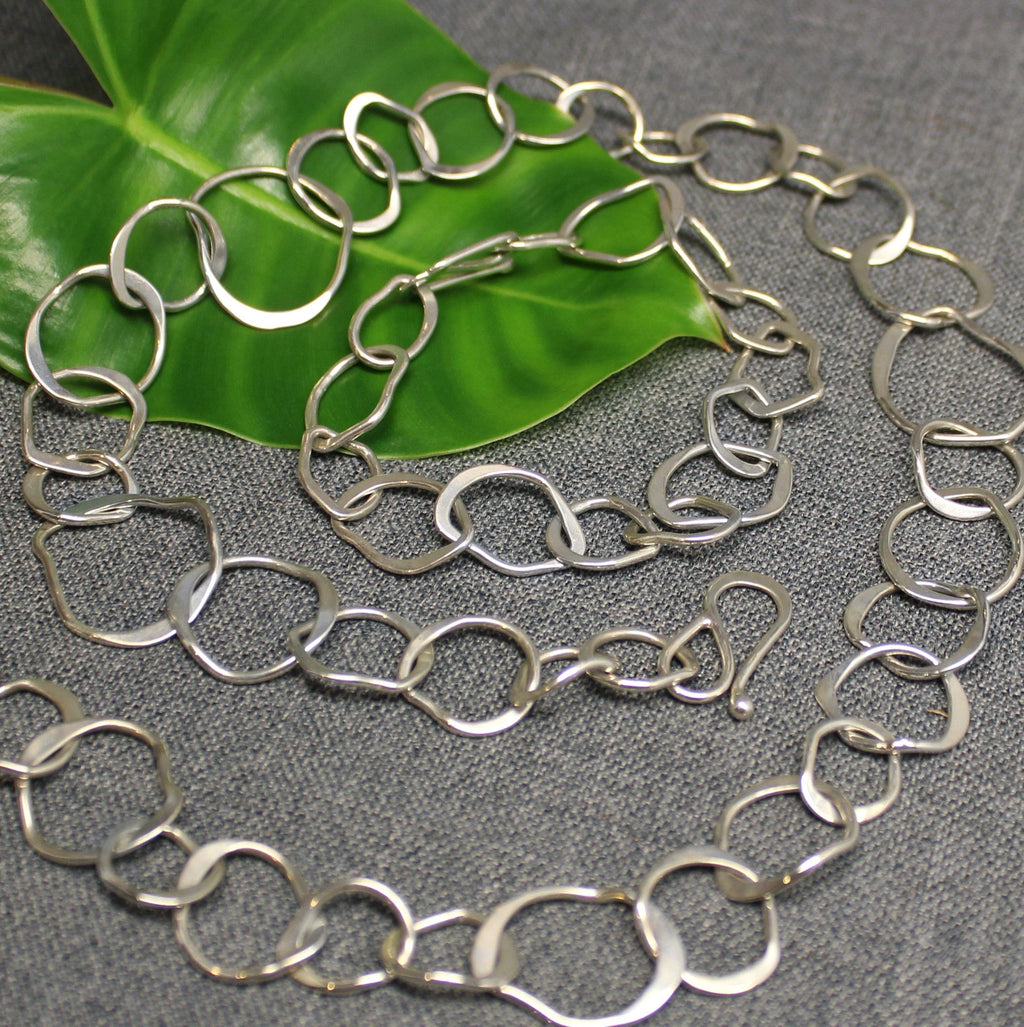 Handcrafted sterling silver chain with shard shapes.