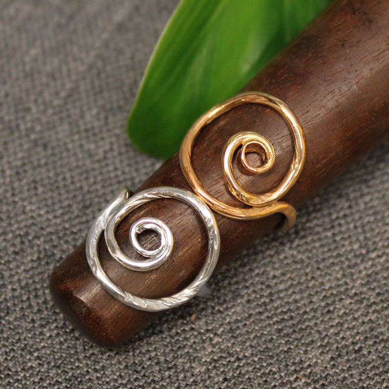 Sterling silver and 14k gold spiral rings.