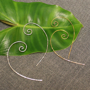 Sterling silver and 14k gold thin spiral wire earrings.