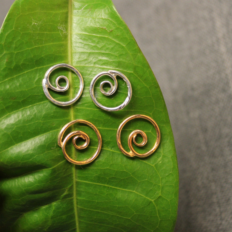 Sterling silver and 14k gold spiral post earrings.
