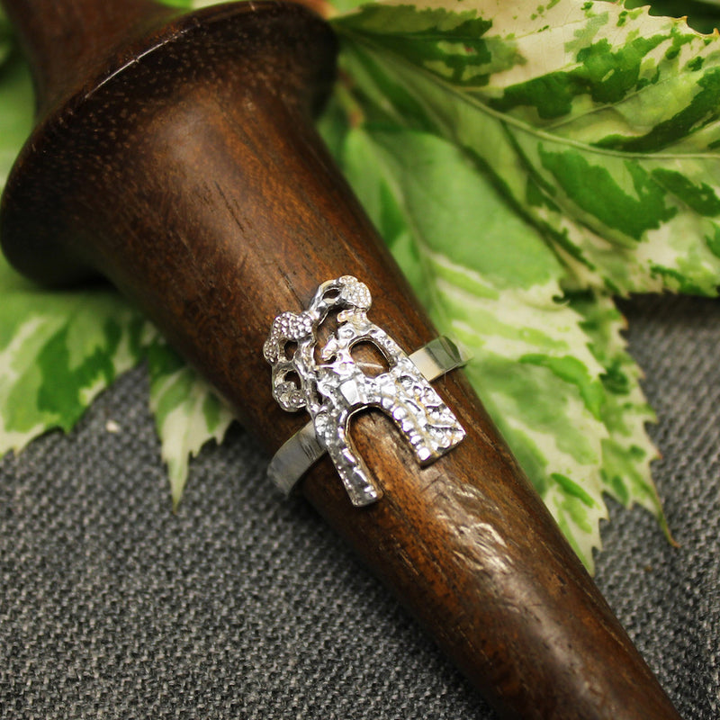 Thin sterling silver ring with handcrafted sugar mill design in center.