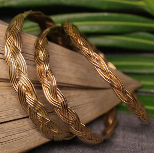 Small, medium and large 14k gold bangles with Turkshead knot rope design.