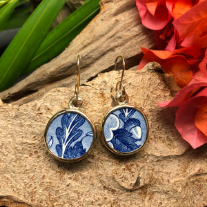 14k gold earrings with round blue Chaney pieces depicting oak leaf and acorn