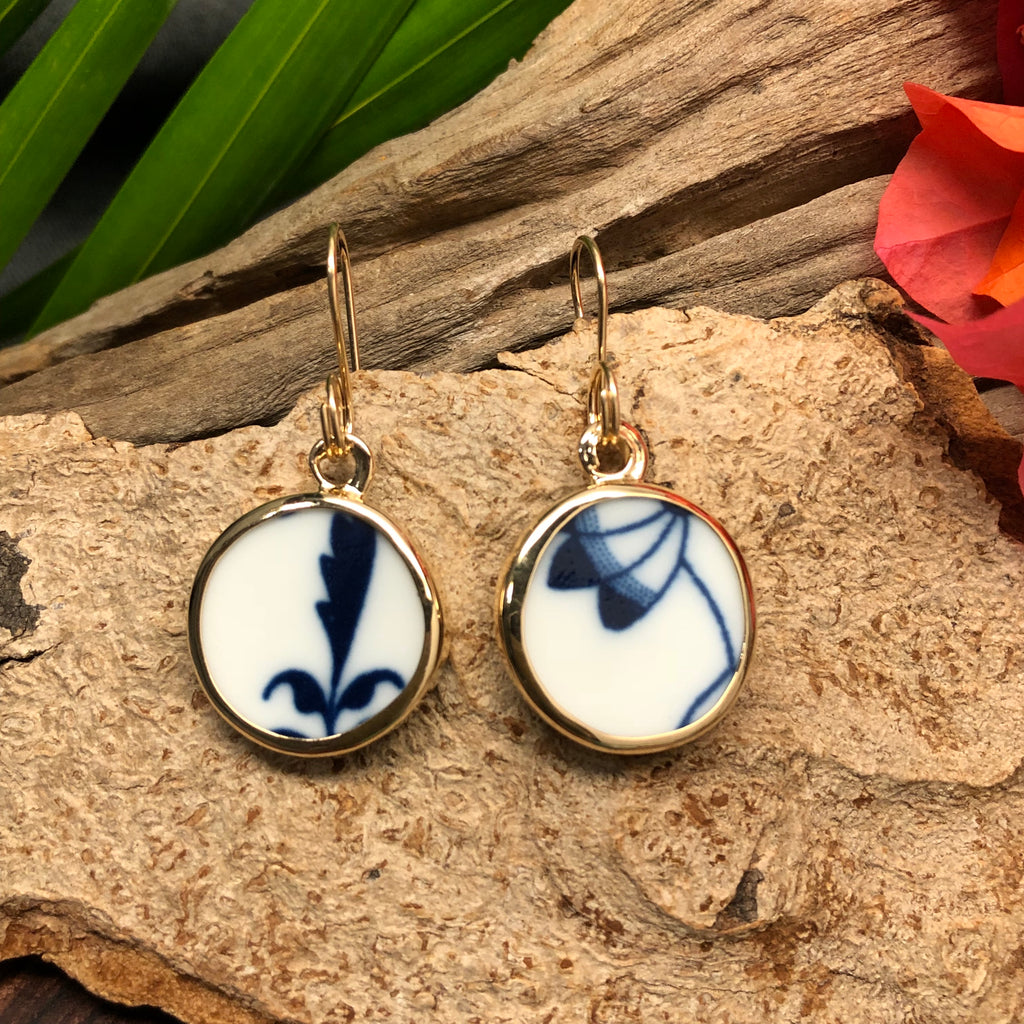 14k gold earrings with round Chaney pieces with white and navy motif