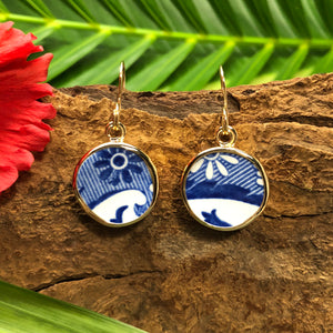 Small round 14k gold earrings with blue and white Chaney inlay with floral design.