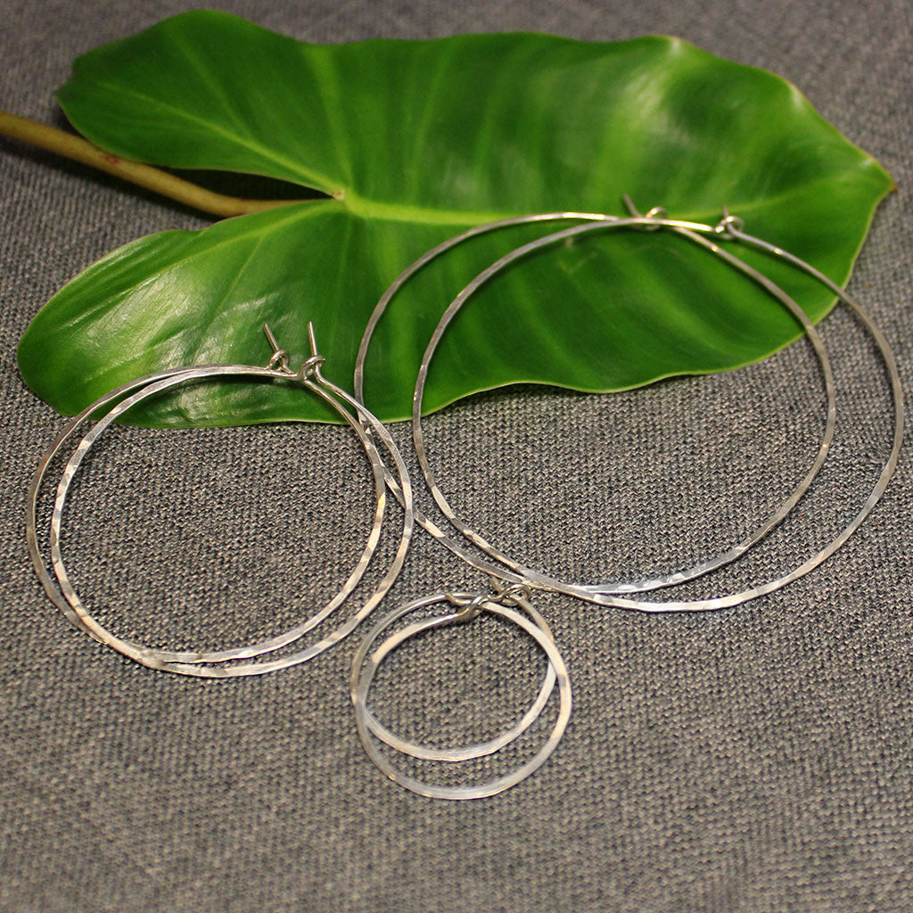 Small, medium and large sterling silver light hoops.