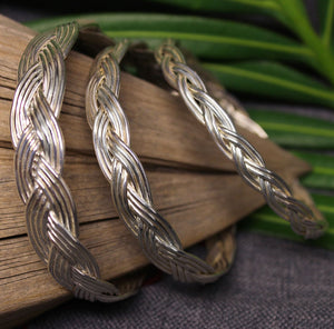 Small, medium and large sterling silver bangles with Turkshead knot rope design.