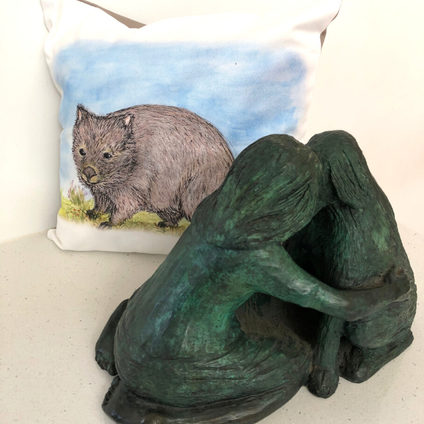 Hatty the Wombat on cushion cover pictured with 'Meeting of Minds' bronze sculpture also by Lucinda Brash