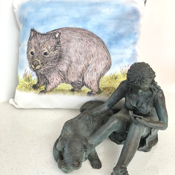 Hatty the Wombat on Cushion Cover pictured with 'Phone Support' bronze sculpture by Lucinda Brash