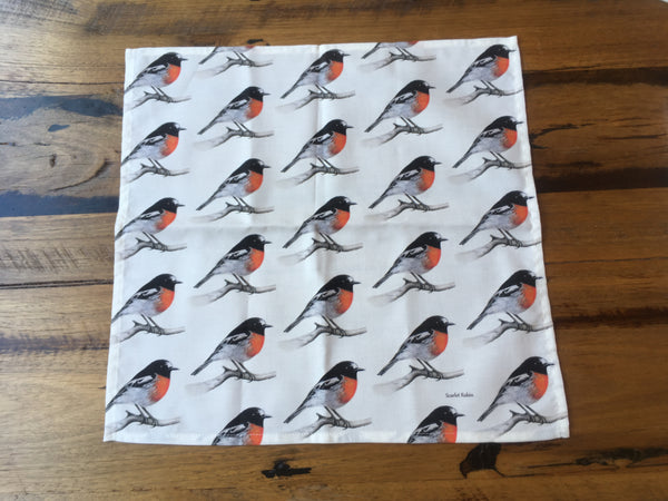 Single cloth napkin or serviette with a repeating patter of the male Scarlet Robin