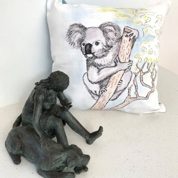 Kala the Koala printed on cushion cover.  Pictured with bronze sculpture 'Phone Support' also by Lucinda Brash