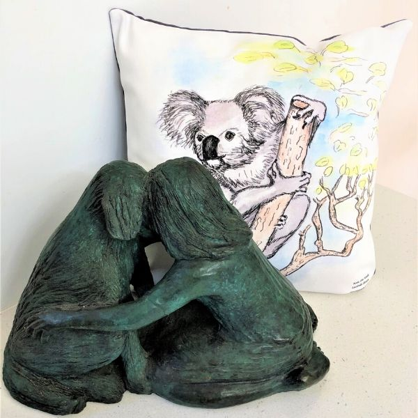 Kala the Koala printed on cushion cover.  Pictured with 'Meeting of Minds' sculpture in bronze by Lucinda Brash