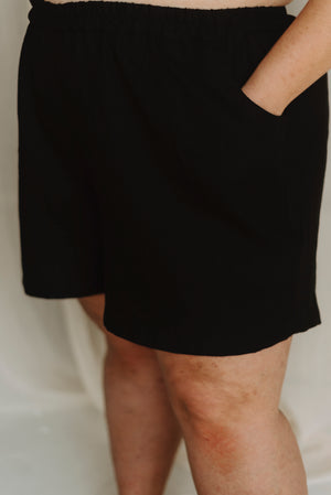 close up view of black linen shorts