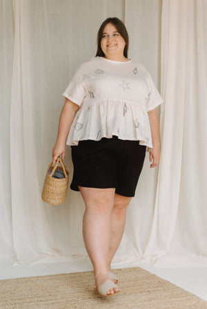 black linen loose fitting shorts worn with shell print top