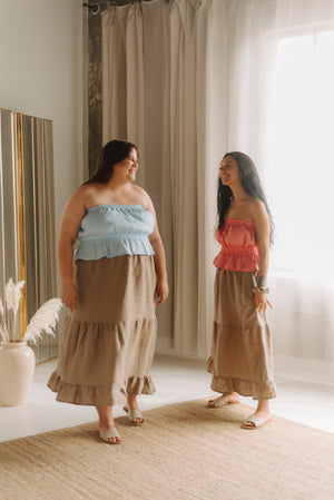 two models wearing matching outfits, one size XXL and the second, size small