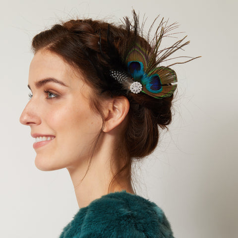 1920s hairstyle for long hair braid and peacock feather clip