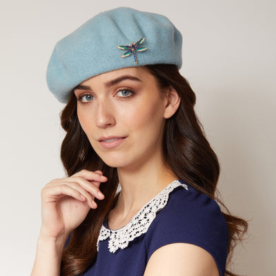 beret with brooch in blue styled