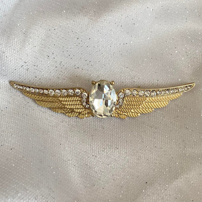 gold brooch winged in crystal