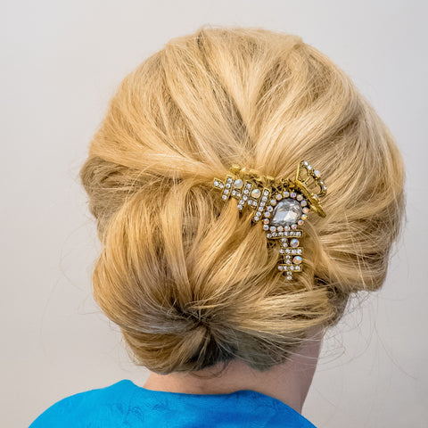gold hair clamp bun updo