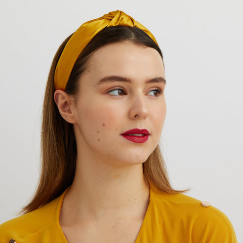 gold knot headband worn with hair down
