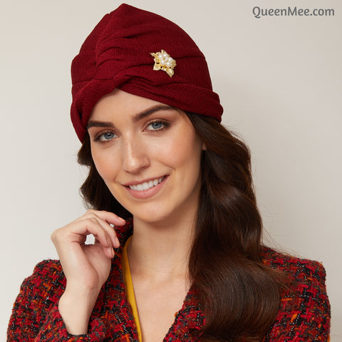 red turban hat with brooch