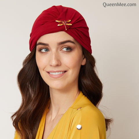 red head wrap with brooch