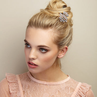 rose gold hair clip claw in blue with bun hairstyle