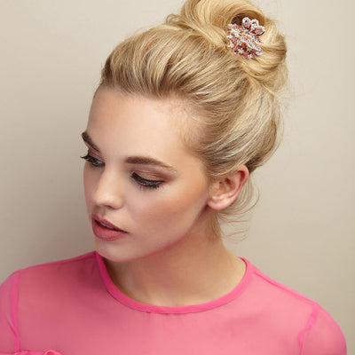 rose gold hair clip claw in pink with bun hairstyle