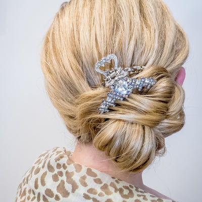 silver claw hair clip worn with bun updo