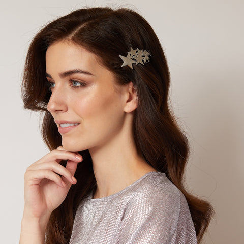 star hair clip in silver styled for prom hair