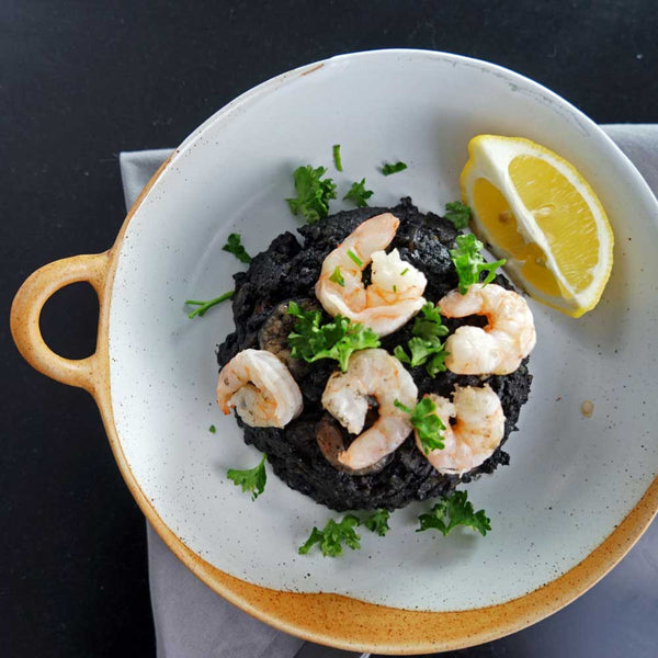 Black squid ink paella with squid and prawns