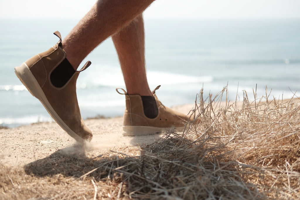 Blundstone Canvas Boot in Sand Colour showing someone walking on the beach